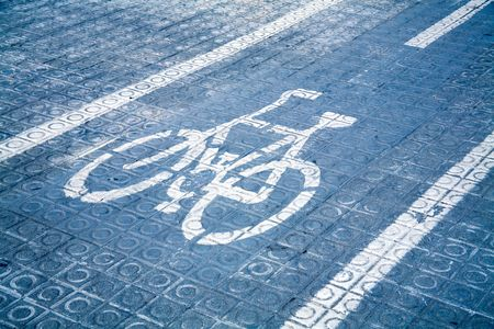 Lane for bicycles on a blue roadway. photo