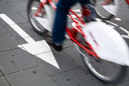 cyclist commuting on an urban cycleway. photo