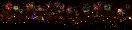 Panoramic night view of Barcelona city with colorful fireworks. Stock Photo