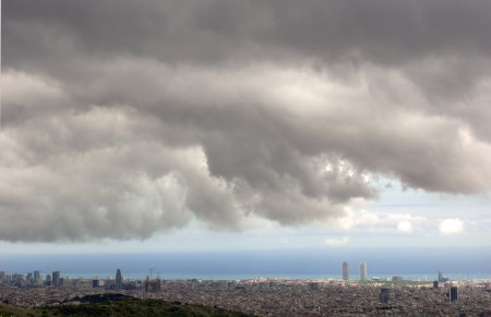 Panoramic view of Barcelona under a stormy sky photo