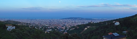 Panoramic view of Barcelona City, Spain at moonrise time. photo