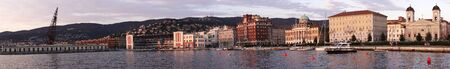TRIESTE - Ago 12. Panorama of Trieste coastline at sunset on summer. On Ago 12, 2012 in Trieste Italy. Stock Photo - 14914571