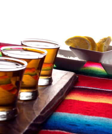Tequila shots with lemon and salt  Shallow focus on lemons