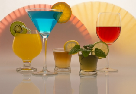 Colorful beverages on different types of glasses