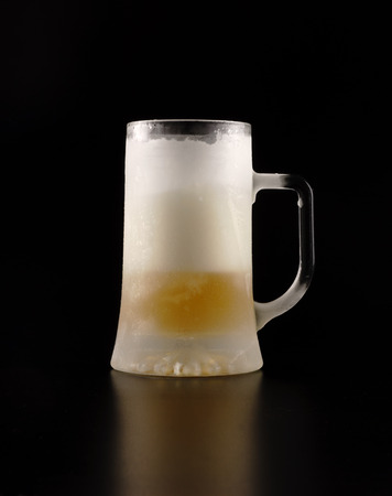 Frozen jug with beer on a black background Stock Photo