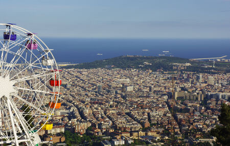 Barcelona, Spain - 2014, April 27  People on a huge ferris wheel with panoramic view over Barcelona   On April 2014 in Barcelona, Spain  Editorial