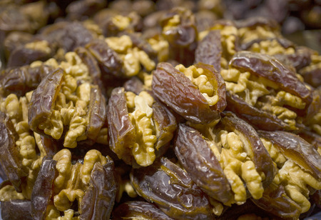 A pile of dates stuffed with walnuts.