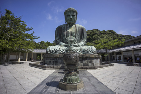 Kamakura, Japan - August 7, 2014: The Great Buddha of Kamakura (Kamakura Daibutsu) is a bronze statue of Amida Buddha, which stands on the grounds of Kotokuin Temple. With a height of 13.35 meters, it is the second tallest bronze Buddha statue in Japan, s Editorial