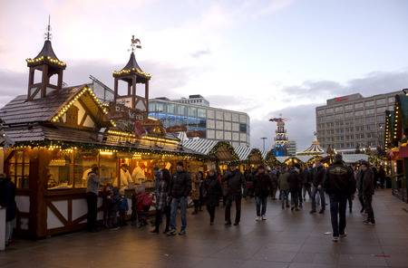 BERLIN - December 26, 2014.  People visiting the Alexanderplatz Christmas Market and eating the tipical food . On December 2014 in Berlin, Germany. Editorial