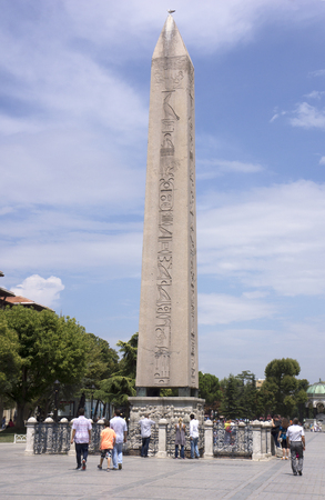 ISTANBUL - August 3, 2014.  People walking around the Obelisk of Theodosius. On August 2014 in Istanbul, Turkey Editorial