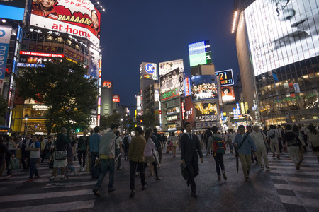 TOKYO - August 28, 2014.  People crossing the famous intersection outside Shibuya Station. On August 2014 in Tokyo, Japan.