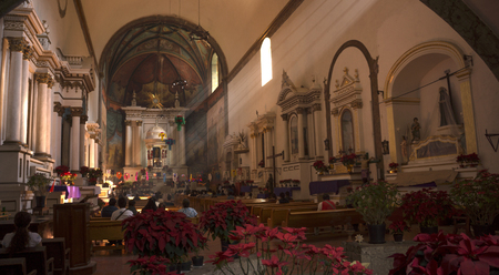 Tepoztlan, Mexico - December 25, 2016: Parishioners praying in the