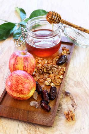 jewish holiday: Apples, walnut, dried fruit and honey: symbols of the Jewish holiday of Rosh Hashanah