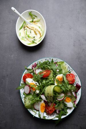 vegetable salad: Vegetable salad with homemade dressing on dark background