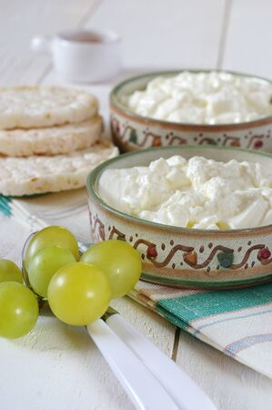 dietetical: Diet breakfast: crispbread, green grapes and cottage cheese in ceramic ware hand-painted