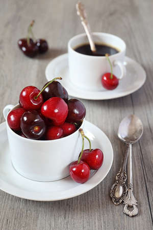 sappy: Sweet cherry and coffee cup Stock Photo