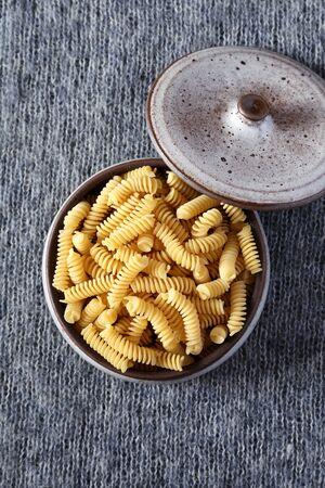 fusilli: Italian pasta fusilli in a ceramic pot