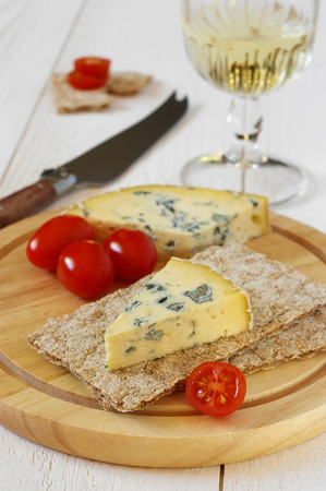 collation: Cold collation: Tomatoes, moldy cheese on crispbread and glass of white wine