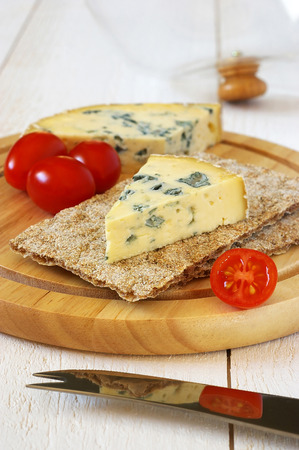 collation: Cold collation: Tomatoes and moldy cheese on crispbread Stock Photo