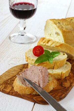 hearty: Hearty Lunch: French maize bread, pate, basil and glass of burgundy