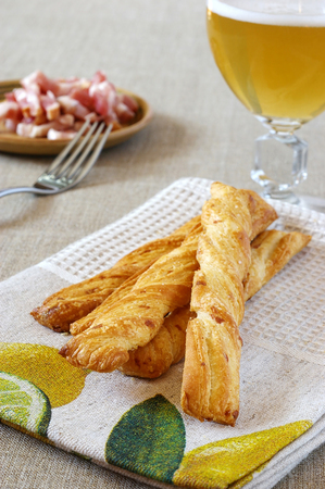 collation: French stick, slab bacon on beautiful linen towel and unpasteurized beer
