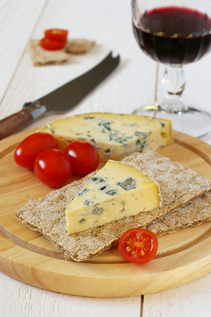 collation: Cold collation: Tomatoes, moldy cheese on crispbread and glass of burgundy Stock Photo