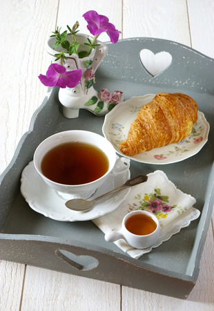 French breakfast in style Shabby chic with flowers on gray tea tray Stock Photo