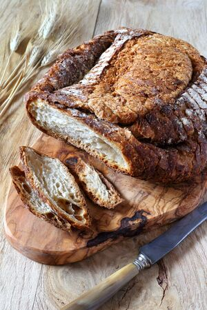 campagne: Traditional French country bread and bred grains Stock Photo