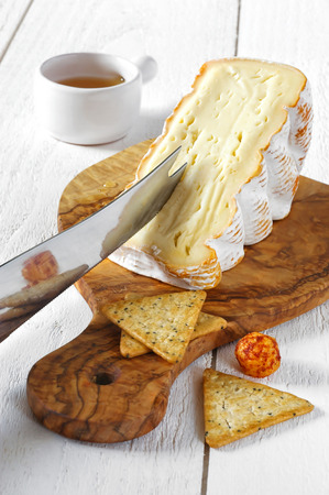 cow's milk cheese: French soft spicy cows milk cheese and honey Stock Photo