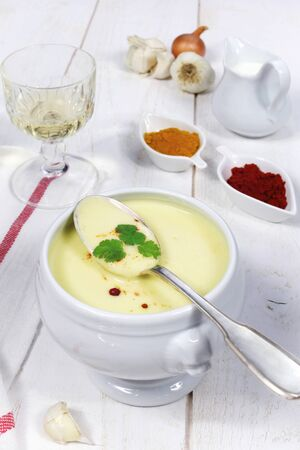 spicery: French cuisine: garlic soup, spicery and a glass of wine Stock Photo