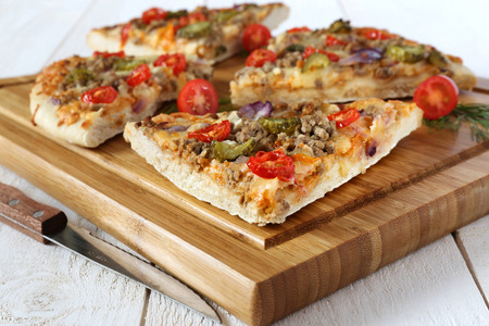 minced meat: Iinternational cuisine: American pizza with tomatoes, pickles and minced meat