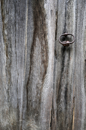 choppy: Texture: fragment of an old wooden door with hardware elements Stock Photo