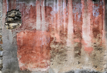 slovenly: Texture: shades of red on a multicolored ancient stucco wall