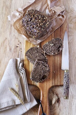 rye bread: Slices of rye bread and knife on cutting board