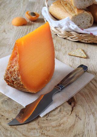 Mimolette, norman cheese and baguette. Focus selective Archivio Fotografico