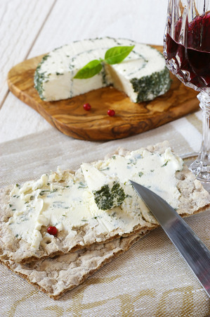 collation: �old collation: Crispbread and French cheese with  Provencal herbs and crystal glass of burgundy