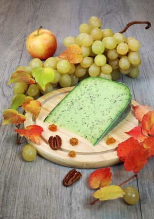 muscat: Green cumin pesto cheese, muscat grape and autumn leaves Stock Photo