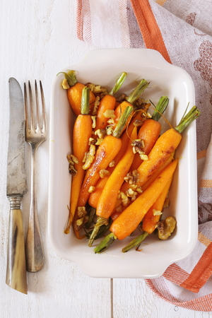 vintage cutlery: Glazed Carrots in ceramic dish and vintage cutlery