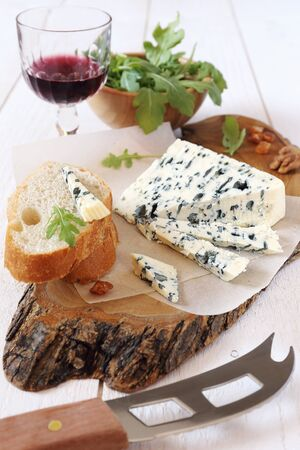 roquefort: French blue cheese Roquefort and glass of red wine