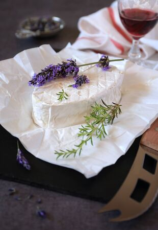 french perfume: Lavender Sprig on cows milk cheese and glass of red wine