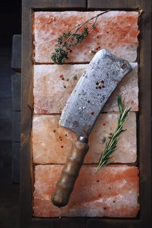 dismal: Sharp butcher knife on pink salt, seasoning
