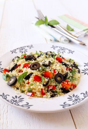 tabbouleh: Couscous, tabbouleh salad with olives and red pepper Stock Photo