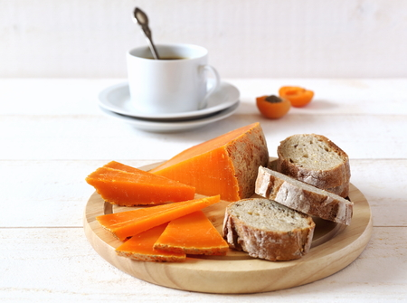 lactic: Mimolette norman cheese, bread and cup of coffee