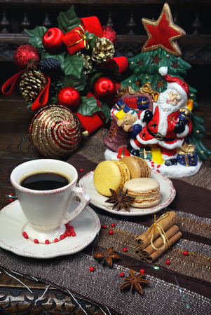 newyear: New-Year  composition: a cup of black coffee and sweet multicolored macaroons Stock Photo