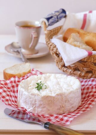 lactic: Breakfast: Camembert cheese, baguette and cup of coffee. Focus selective Stock Photo