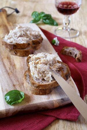 French rillettes: pork pate with bread and glass of red wine Stock Photo