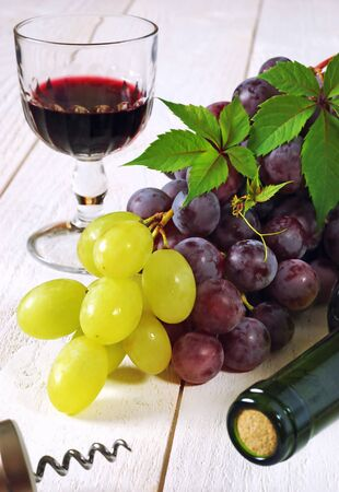 Wine Theme, Fruit-piece: red and green grapes, bottle, corkscrew and glass of red wine