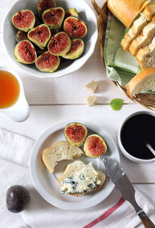 lactic: Ripe figs, blue cheese, honey, baguette and cup of coffee Stock Photo