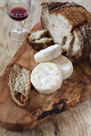 queso de cabra: French Goat cheese, french country  bread and glass of red wine