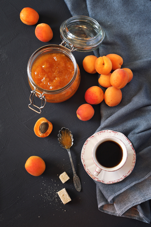 bocal: Still life: Apricots, apricot jam  in jam jar and cup of coffee Stock Photo